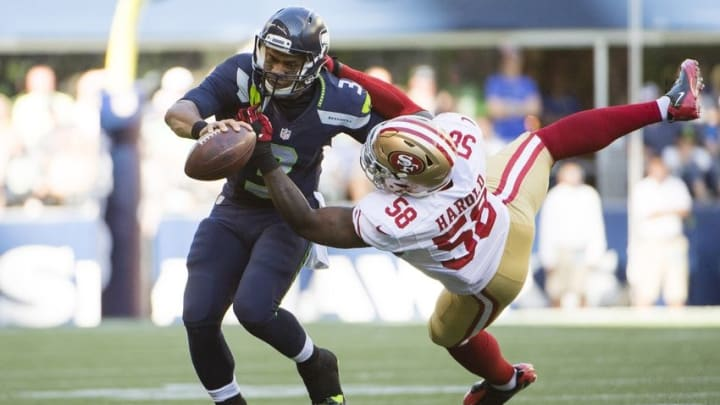 Sep 25, 2016; Seattle, WA, USA; Seattle Seahawks quarterback Russell Wilson (3) is tackled by San Francisco 49ers outside linebacker Eli Harold (58) during the third quarter at CenturyLink Field. Wilson was injured on the play. The Seahawks won 37-18. Mandatory Credit: Troy Wayrynen-USA TODAY Sports