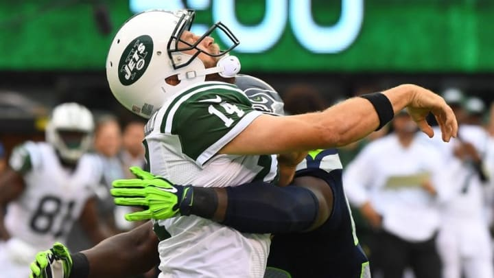 Oct 2, 2016; East Rutherford, NJ, USA; New York Jets quarterback Ryan Fitzpatrick (14) gets hit by Seattle Seahawks defensive end Frank Clark (55) in the first quarter at MetLife Stadium. Mandatory Credit: Robert Deutsch-USA TODAY Sports