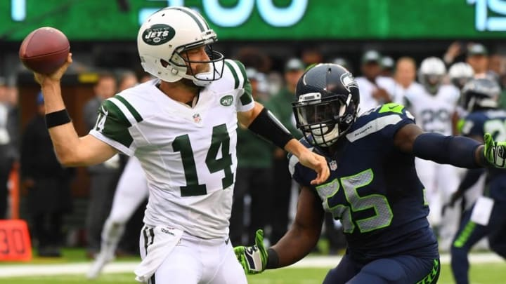 Oct 2, 2016; East Rutherford, NJ, USA; New York Jets quarterback Ryan Fitzpatrick (14) looks to pass while defended by Seattle Seahawks defensive end Frank Clark (55) in the first quarter at MetLife Stadium. Mandatory Credit: Robert Deutsch-USA TODAY Sports