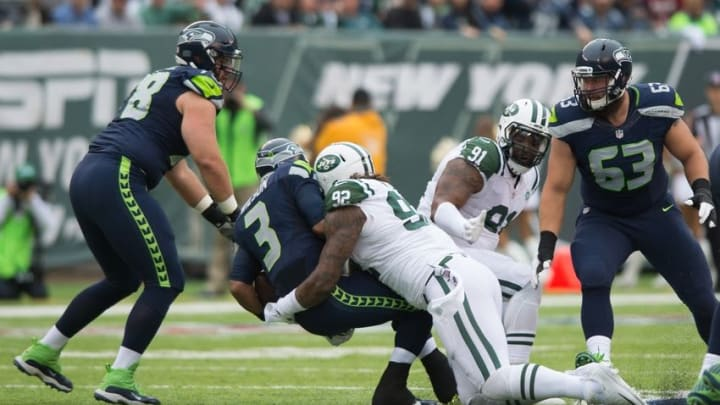 Oct 2, 2016; East Rutherford, NJ, USA; New York Jets defensive tackle Leonard Williams (92) sacks Seattle Seahawks quarterback Russell Wilson (3) in the first half at MetLife Stadium. Mandatory Credit: William Hauser-USA TODAY Sports