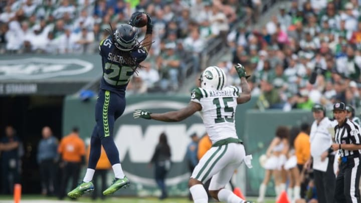 Oct 2, 2016; East Rutherford, NJ, USA; Seattle Seahawks cornerback Richard Sherman (25) intercepts a pass in front of New York Jets wide receiver Brandon Marshall (15) in the second half at MetLife Stadium. Seattle Seahawks defeat the New York Jets 27-17. Mandatory Credit: William Hauser-USA TODAY Sports