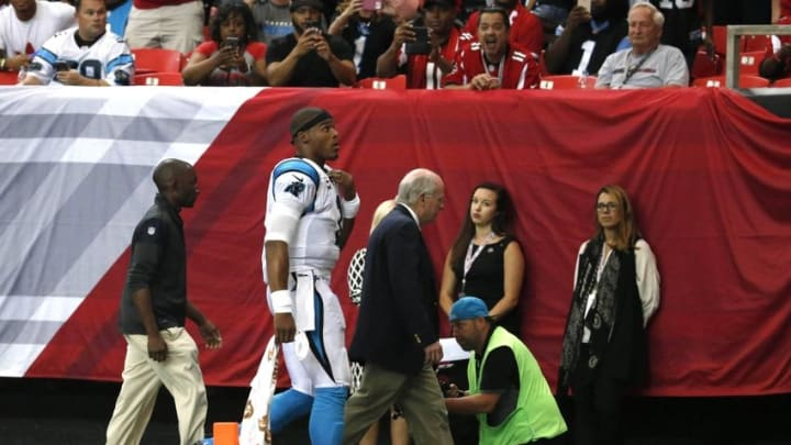 Oct 2, 2016; Atlanta, GA, USA; Carolina Panthers quarterback Cam Newton (1) walks off of the field after getting injured in the fourth quarter of their game against the Atlanta Falcons at the Georgia Dome. The Falcons won 48-33. Mandatory Credit: Jason Getz-USA TODAY Sports
