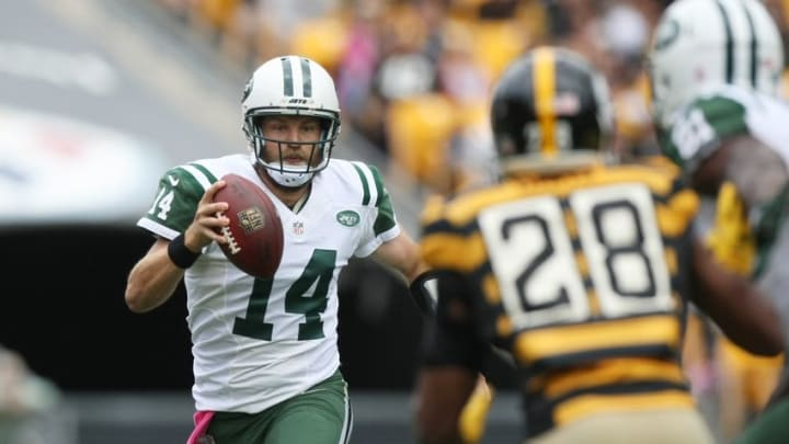 Oct 9, 2016; Pittsburgh, PA, USA; New York Jets quarterback Ryan Fitzpatrick (14) looks to pass against Pittsburgh Steelers safety Sean Davis (28) during the first quarter of their game at Heinz Field. Mandatory Credit: Jason Bridge-USA TODAY Sports