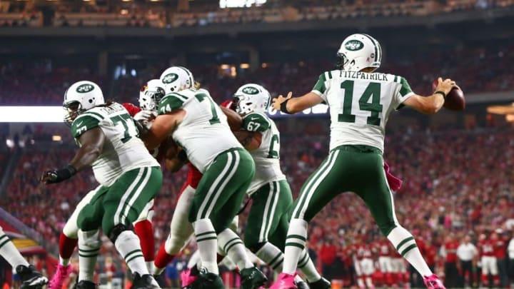 Oct 17, 2016; Glendale, AZ, USA; New York Jets quarterback Ryan Fitzpatrick (14) throws a pass against the Arizona Cardinals in the first quarter at University of Phoenix Stadium. Mandatory Credit: Mark J. Rebilas-USA TODAY Sports