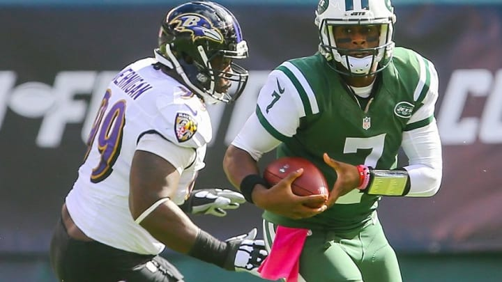 Oct 23, 2016; East Rutherford, NJ, USA; New York Jets quarterback Geno Smith (7) runs with the ball while being defended by Baltimore Ravens defensive end Timmy Jernigan (99) during the first half at MetLife Stadium. Mandatory Credit: Ed Mulholland-USA TODAY Sports