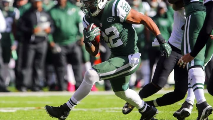 Oct 23, 2016; East Rutherford, NJ, USA; New York Jets running back Matt Forte (22) runs with the ball during the second half at MetLife Stadium. The Jets defeated the Ravens 24-16. Mandatory Credit: Ed Mulholland-USA TODAY Sports