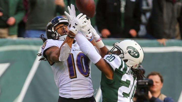 Oct 23, 2016; East Rutherford, NJ, USA; New York Jets cornerback Marcus Williams (20) breaks up a pass intended for Baltimore Ravens wide receiver Chris Moore (10) during the second half at MetLife Stadium. The Jets defeated the Ravens 24-16. Mandatory Credit: Ed Mulholland-USA TODAY Sports