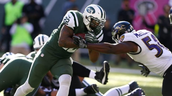 Oct 23, 2016; East Rutherford, NJ, USA; New York Jets running back Matt Forte (22) rushes for a touchdown against Baltimore Ravens outside linebacker Elvis Dumervil (58) during second half at MetLife Stadium. The New York Jets defeated the Baltimore Ravens 24-16. Mandatory Credit: Noah K. Murray-USA TODAY Sports