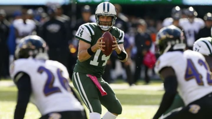 Oct 23, 2016; East Rutherford, NJ, USA; New York Jets quarterback Ryan Fitzpatrick (14) drops back to pass against Baltimore Ravens during second half at MetLife Stadium. The New York Jets defeated the Baltimore Ravens 24-16. Mandatory Credit: Noah K. Murray-USA TODAY Sports
