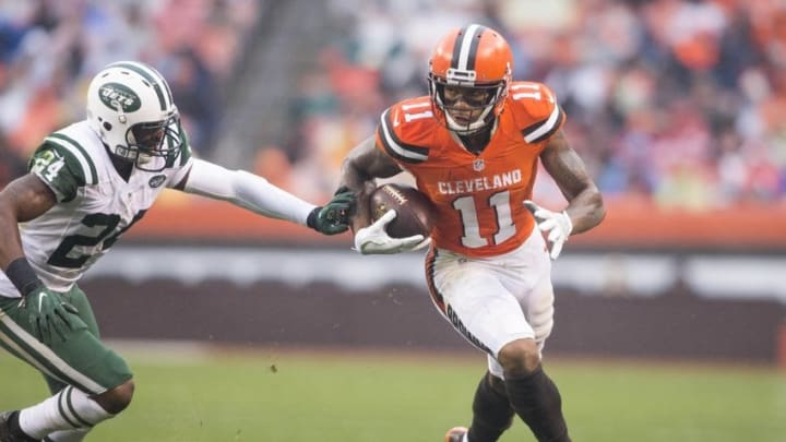 Oct 30, 2016; Cleveland, OH, USA; Cleveland Browns wide receiver Terrelle Pryor (11) runs the ball for a first down against New York Jets cornerback Darrelle Revis (24) during the second quarter at FirstEnergy Stadium. Mandatory Credit: Scott R. Galvin-USA TODAY Sports