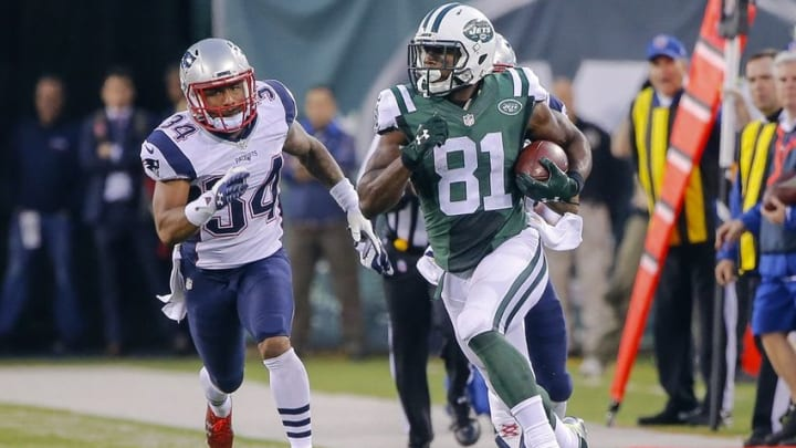 Dec 27, 2015; East Rutherford, NJ, USA; New York Jets wide receiver Quincy Enunwa (81) runs the ball during overtime against New England Patriots cornerback Leonard Johnson (34) at MetLife Stadium. New York Jets defeat the New England Patriots 26-20 in OT. Mandatory Credit: Jim O
