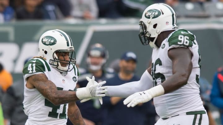 Oct 2, 2016; East Rutherford, NJ, USA; New York Jets cornerback Buster Skrine (41) and New York Jets defensive end Muhammad Wilkerson (96) celebrate after a sack in the second half at MetLife Stadium. Seattle Seahawks defeat the New York Jets 27-17. Mandatory Credit: William Hauser-USA TODAY Sports