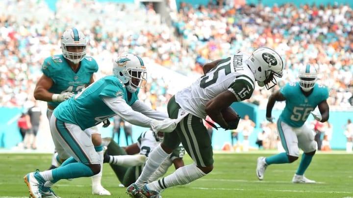 Nov 6, 2016; Miami Gardens, FL, USA; Miami Dolphins cornerback Byron Maxwell (41) tackles New York Jets wide receiver Brandon Marshall (15) during the first half at Hard Rock Stadium. Mandatory Credit: Jasen Vinlove-USA TODAY Sports