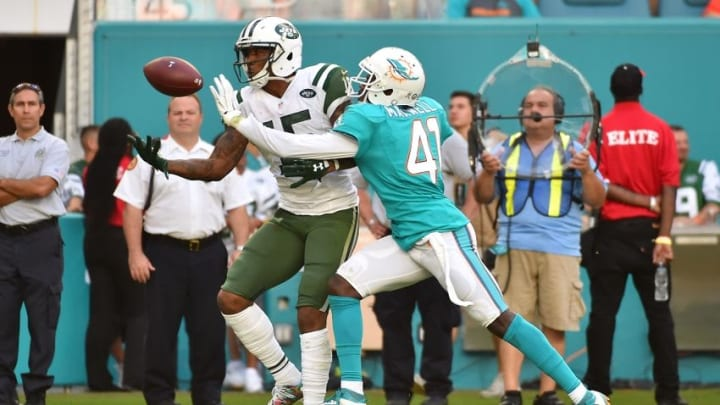 Nov 6, 2016; Miami Gardens, FL, USA; Miami Dolphins middle linebacker Kiko Alonso (47) is called for pass interference on New York Jets wide receiver Brandon Marshall (15) during the second half at Hard Rock Stadium. The Miami Dolphins defeat the New York Jets 27-23. Mandatory Credit: Jasen Vinlove-USA TODAY Sports