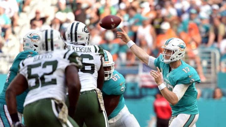 Nov 6, 2016; Miami Gardens, FL, USA; Miami Dolphins quarterback Ryan Tannehill (17) throws a pass during the second half against the New York Jets at Hard Rock Stadium. The Dolphins won 27-23. Mandatory Credit: Steve Mitchell-USA TODAY Sports
