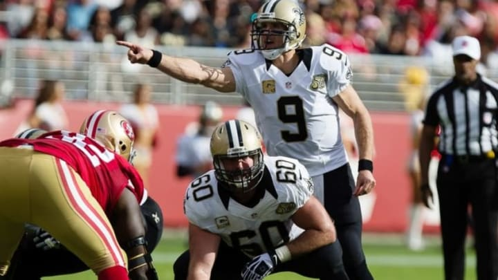 Nov 6, 2016; Santa Clara, CA, USA; New Orleans Saints quarterback Drew Brees (9) calls out before receiving a snap from center Max Unger (60) against the San Francisco 49ers during the second quarter at Levi