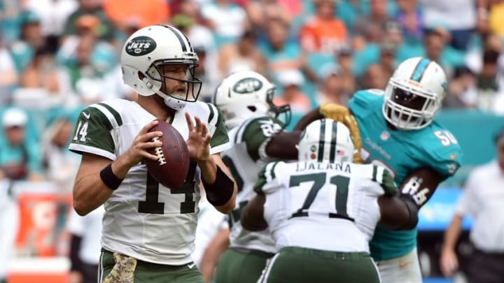 Nov 6, 2016; Miami Gardens, FL, USA; New York Jets quarterback Ryan Fitzpatrick (14) throws a pass during the second half against the Miami Dolphins at Hard Rock Stadium. The Dolphins won 27-23. Mandatory Credit: Steve Mitchell-USA TODAY Sports