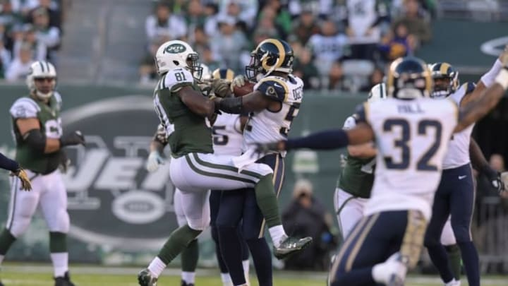 Nov 13, 2016; East Rutherford, NJ, USA; Los Angeles Rams linebacker Alec Ogletree (52) intercepts a pass intended for New York Jets wide receiver Quincy Enunwa (81) in the fourth quarter during a NFL football game at MetLife Stadium. The Rams defeated the Jets 9-6. Mandatory Credit: Kirby Lee-USA TODAY Sports