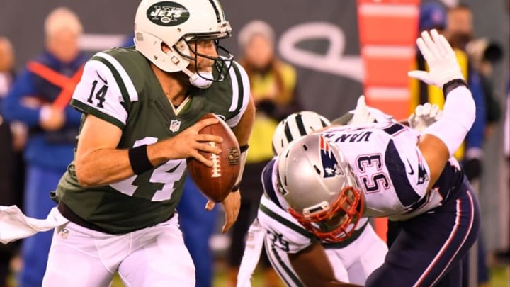 Nov 27, 2016; East Rutherford, NJ, USA; New York Jets quarterback Ryan Fitzpatrick (14) runs with the ball against the New England Patriots during the first half at MetLife Stadium. Mandatory Credit: Robert Deutsch-USA TODAY Sports