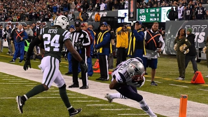 Nov 27, 2016; East Rutherford, NJ, USA; New England Patriots wide receiver Malcolm Mitchell (19) scores the game winning touchdown in front of New York Jets cornerback Darrelle Revis (24) during the second half at MetLife Stadium. Mandatory Credit: Robert Deutsch-USA TODAY Sports