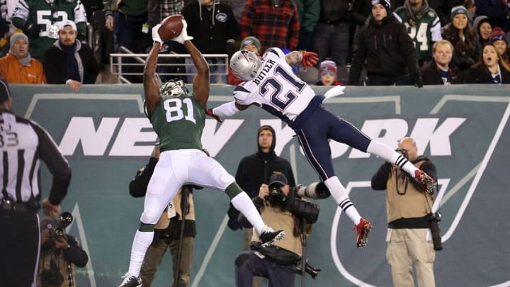 Nov 27, 2016; East Rutherford, NJ, USA; New York Jets wide receiver Quincy Enunwa (81) catches a touchdown pass over New England Patriots corner back Malcolm Butler (21) during the fourth quarter at MetLife Stadium. Mandatory Credit: Brad Penner-USA TODAY Sports