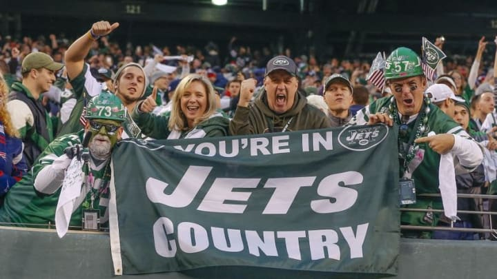 Dec 27, 2015; East Rutherford, NJ, USA; New York Jets fans celebrate an overtime victory over the New England Patriots at MetLife Stadium. New York Jets defeat the New England Patriots 26-20 in OT. Mandatory Credit: Jim O
