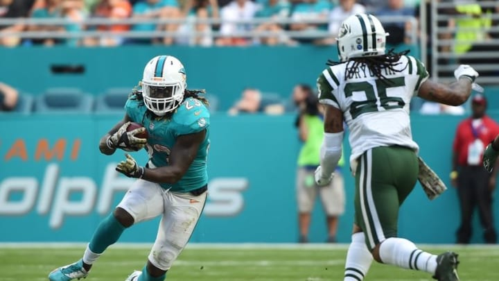 Nov 6, 2016; Miami Gardens, FL, USA; Miami Dolphins running back Jay Ajayi (23) carries the ball as New York Jets safety Calvin Pryor (25) makes the tackle during the second half at Hard Rock Stadium. The Dolphins won 27-23. Mandatory Credit: Steve Mitchell-USA TODAY Sports