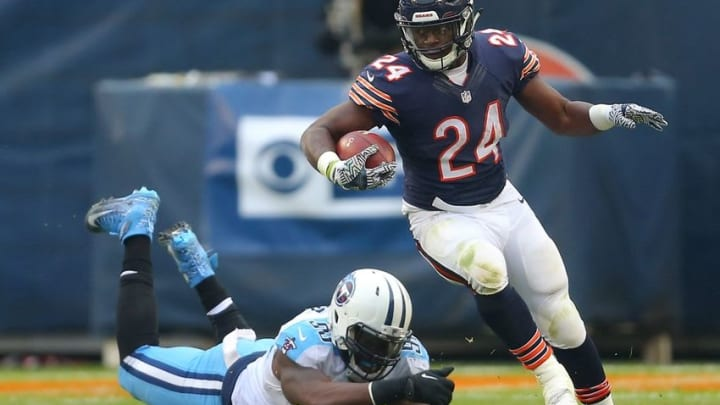 Nov 27, 2016; Chicago, IL, USA; Chicago Bears running back Jordan Howard (24) runs with the ball during the second quarter against the Tennessee Titans at Soldier Field. Mandatory Credit: Dennis Wierzbicki-USA TODAY Sports