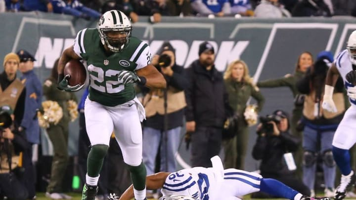 Dec 5, 2016; East Rutherford, NJ, USA; New York Jets running back Matt Forte (22) runs with the ball during the first half of their game against the Indianapolis Colts at MetLife Stadium. Mandatory Credit: Ed Mulholland-USA TODAY Sports
