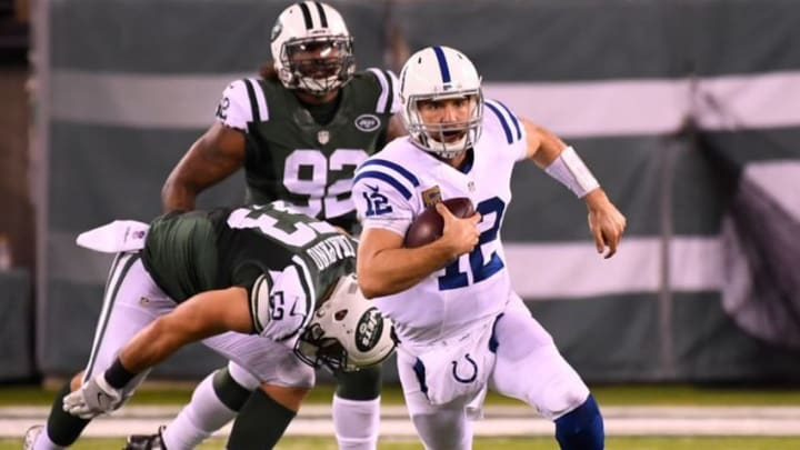 Dec 5, 2016; East Rutherford, NJ, USA; Indianapolis Colts quarterback Andrew Luck (12) carries on a first down keeper in the second half against the New York Jets at MetLife Stadium. Mandatory Credit: Robert Deutsch-USA TODAY Sports