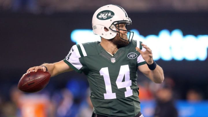 Dec 17, 2016; East Rutherford, NJ, USA; New York Jets quarterback Ryan Fitzpatrick (14) throws a pass during warm ups before a game against the Miami Dolphins at MetLife Stadium. Mandatory Credit: Brad Penner-USA TODAY Sports