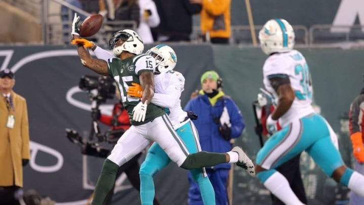 Dec 17, 2016; East Rutherford, NJ, USA; Miami Dolphins corner back Xavien Howard (25) breaks up a pass intended for New York Jets wide receiver Brandon Marshall (15) during the second quarter at MetLife Stadium. Mandatory Credit: Brad Penner-USA TODAY Sports