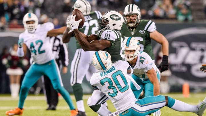 Dec 17, 2016; East Rutherford, NJ, USA; New York Jets wide receiver Quincy Enunwa (81) makes a catch and is tackled by Miami Dolphins free safety Bacarri Rambo (30) in the third quarter at MetLife Stadium. Mandatory Credit: Dennis Schneidler-USA TODAY Sports