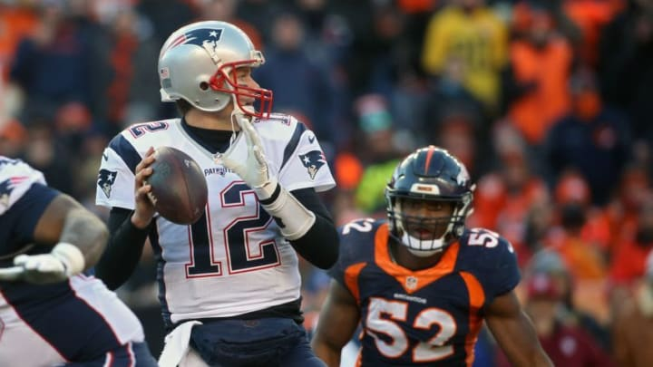 Dec 18, 2016; Denver, CO, USA; New England Patriots quarterback Tom Brady (12) looks to pass the ball as Denver Broncos inside linebacker Corey Nelson (52) approaches during the first half at Sports Authority Field. Mandatory Credit: Chris Humphreys-USA TODAY Sports