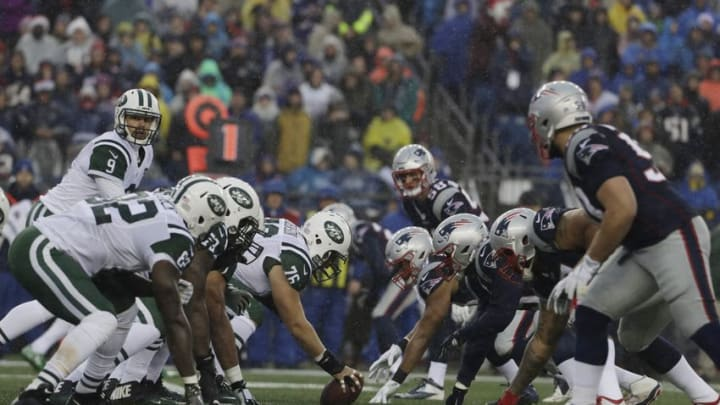 Dec 24, 2016; Foxborough, MA, USA; New York Jets quarterback Bryce Petty (9) prepares for a snap against the New England Patriots in the first quarter at Gillette Stadium. Mandatory Credit: David Butler II-USA TODAY Sports