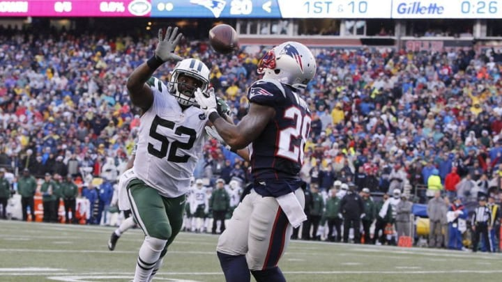 Dec 24, 2016; Foxborough, MA, USA; New England Patriots running back James White (28) makes the touchdown in front of New York Jets middle linebacker David Harris (52) in the second quarter at Gillette Stadium. Mandatory Credit: David Butler II-USA TODAY Sports