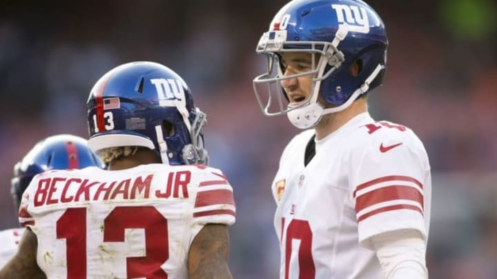 Nov 27, 2016; Cleveland, OH, USA; New York Giants quarterback Eli Manning (10) congratulates wide receiver Odell Beckham Jr. (13) on his touchdown reception during the fourth quarter against the Cleveland Browns at FirstEnergy Stadium. The Giants won 27-13. Mandatory Credit: Scott R. Galvin-USA TODAY Sports