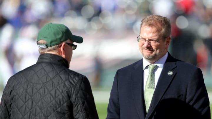 Jan 1, 2017; East Rutherford, NJ, USA; New York Jets owner Woody Johnson (left) talks with general manager Mike Maccagnan on the field before a game against the Buffalo Bills at MetLife Stadium. Mandatory Credit: Brad Penner-USA TODAY Sports