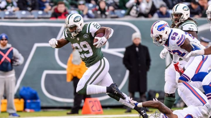 Jan 1, 2017; East Rutherford, NJ, USA; New York Jets running back Bilal Powell (29) breaks the tackle of Buffalo Bills cornerback Corey White (30) during the 3rd quarter at MetLife Stadium. Mandatory Credit: Dennis Schneidler-USA TODAY Sports