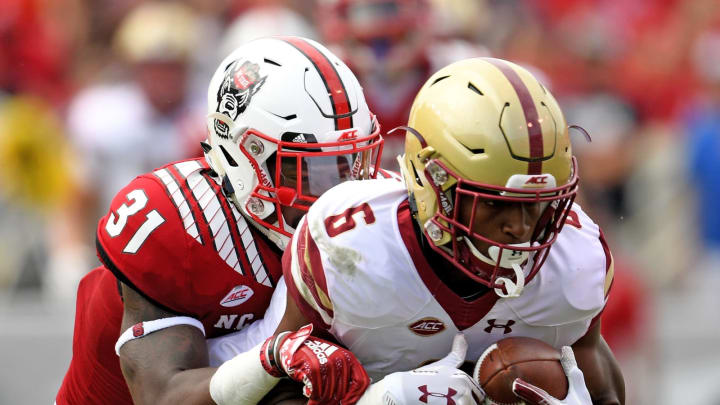 RALEIGH, NC – OCTOBER 06: Jeff Smith #6 of the Boston College Eagles makes a catch against Jarius Morehead #31 of the North Carolina State Wolfpack during their game at Carter-Finley Stadium on October 6, 2018 in Raleigh, North Carolina. North Carolina State won 28-23. (Photo by Grant Halverson/Getty Images)