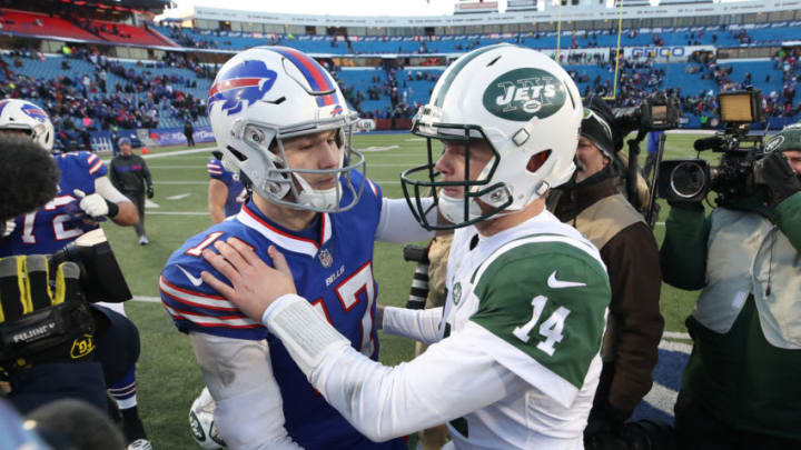 BUFFALO, NY - DECEMBER 09: Josh Allen #17 of the Buffalo Bills shares an embrace with Sam Darnold #14 of the New York Jets after their NFL game at New Era Field on December 9, 2018 in Buffalo, New York. (Photo by Tom Szczerbowski/Getty Images)