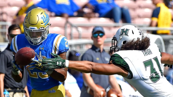 PASADENA, CA – SEPTEMBER 09: Nate Starks #23 of the UCLA Bruins hangs on to the ball to complete a 39 yard pass play before he is stopped by Jahlani Tavai #31 of the Hawaii Warriors in the first half of the game at the Rose Bowl on September 9, 2017 in Pasadena, California. (Photo by Jayne Kamin-Oncea/Getty Images)
