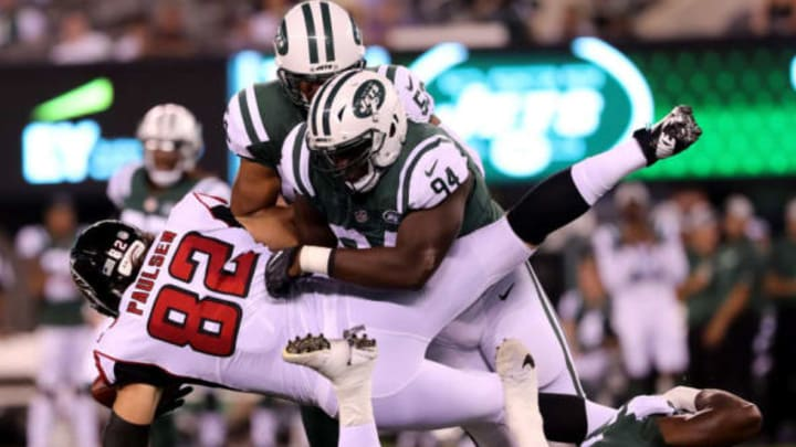 EAST RUTHERFORD, NJ – AUGUST 10: Folorunso Fatukasi #94 of the New York Jets tackles Logan Paulsen #82 of the Atlanta Falcons in the first half during a preseason game at MetLife Stadium on August 10, 2018 in East Rutherford, New Jersey. (Photo by Elsa/Getty Images)