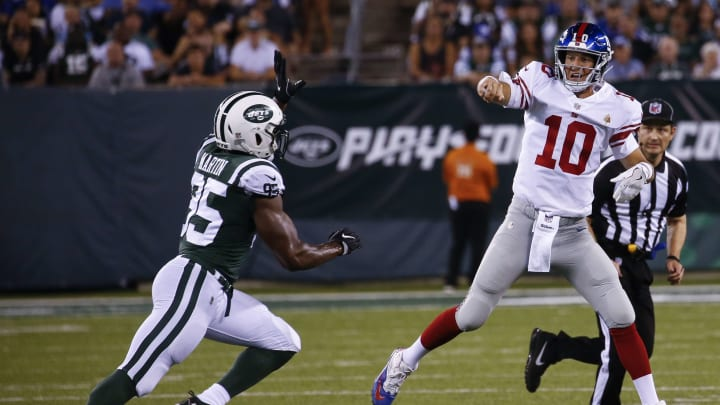 EAST RUTHERFORD, NJ – AUGUST 24: Eli Manning #10 of the New York Giants passes under pressure from Josh Martin #95 of the New York Jets during their preseason game at MetLife Stadium on August 24, 2018 in East Rutherford, New Jersey. (Photo by Jeff Zelevansky/Getty Images)
