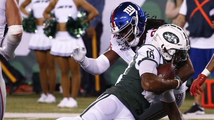 EAST RUTHERFORD, NJ – AUGUST 24: Avery Moss #91 of the New York Giants takes down ArDarius Stewart #18 of the New York Jets during their preseason game at MetLife Stadium on August 24, 2018 in East Rutherford, New Jersey. (Photo by Jeff Zelevansky/Getty Images)