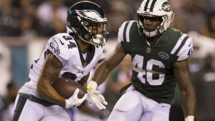 PHILADELPHIA, PA - AUGUST 30: DJ Pumphrey #34 of the Philadelphia Eagles runs with the ball against Neville Hewitt #46 of the New York Jets in the second quarter during the preseason game at Lincoln Financial Field on August 30, 2018 in Philadelphia, Pennsylvania. (Photo by Mitchell Leff/Getty Images)