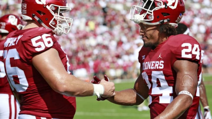 NORMAN, OK - SEPTEMBER 01: Running back Rodney Anderson #24 and offensive lineman Creed Humphrey #56 of the Oklahoma Sooners meet during warm ups before the game against the Florida Atlantic Owls at Gaylord Family Oklahoma Memorial Stadium on September 1, 2018 in Norman, Oklahoma. The Sooners defeated the Owls 63-14. (Photo by Brett Deering/Getty Images)