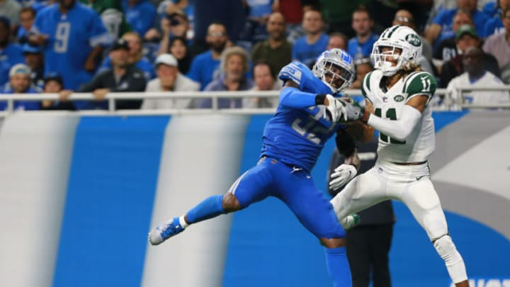 DETROIT, MI - SEPTEMBER 10: Robby Anderson #11 of the New York Jets scores a touchdown in front of Tavon Wilson #32 of the Detroit Lions in the second quarter at Ford Field on September 10, 2018 in Detroit, Michigan. (Photo by Rey Del Rio/Getty Images)