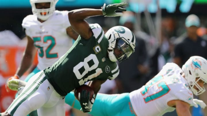 EAST RUTHERFORD, NJ - SEPTEMBER 16: Wide receiver Quincy Enunwa #81 of the New York Jets carries the ball against quarterback Ryan Tannehill #17 of the Miami Dolphins during the first half at MetLife Stadium on September 16, 2018 in East Rutherford, New Jersey. The Miami Dolphins won 20-12. (Photo by Elsa/Getty Images)