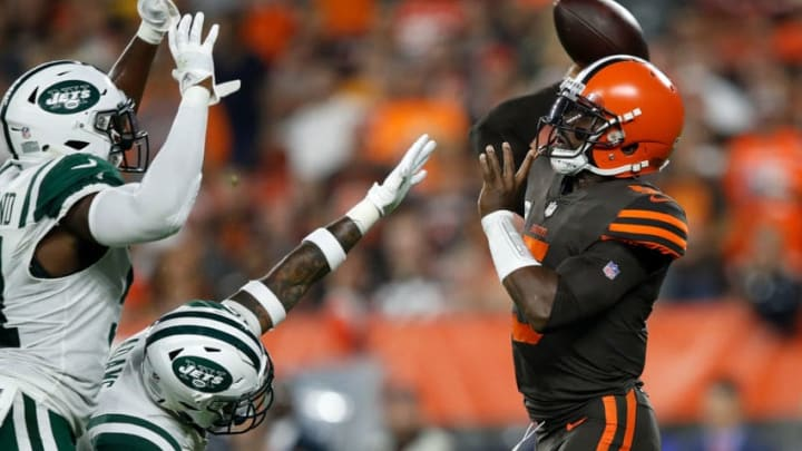 CLEVELAND, OH - SEPTEMBER 20: Tyrod Taylor #5 of the Cleveland Browns throws a pass in front of the defense of Brandon Copeland #51 and Jamal Adams #33 of the New York Jets during the first quarter at FirstEnergy Stadium on September 20, 2018 in Cleveland, Ohio. (Photo by Joe Robbins/Getty Images)
